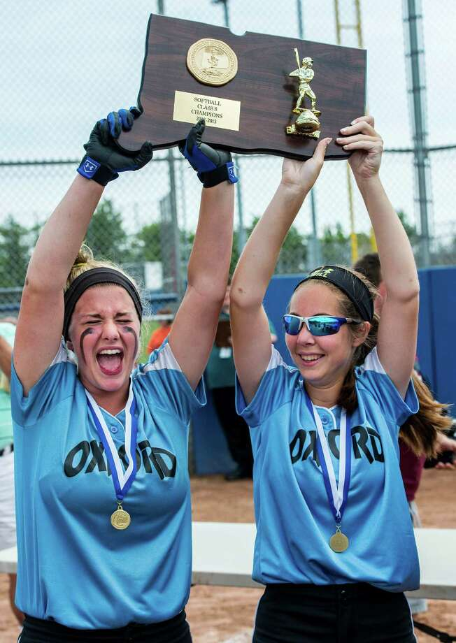 Oxford high school's Marisa Downs and Dallas Passerine hold up the CIAC class S softball championship plaque after defeating Terryville high school in the game played at West Haven high school, West Haven, CT on Sunday June 9th, 2013. Photo: Mark Conrad / Connecticut Post Freelance