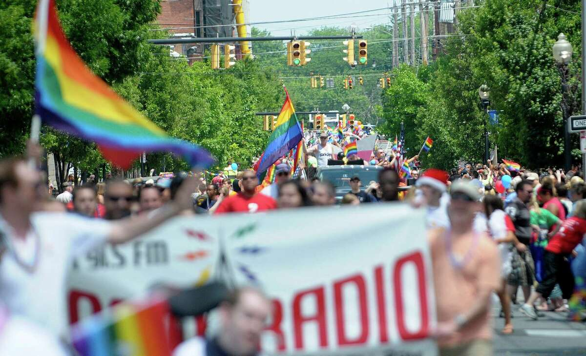 Marchers head up Lark Street during the Capital Pride 2013 Parade on Sunday, June 9, 2013 in Albany, NY. A festival in Washington Park followed the parade. (Paul Buckowski / Times Union)