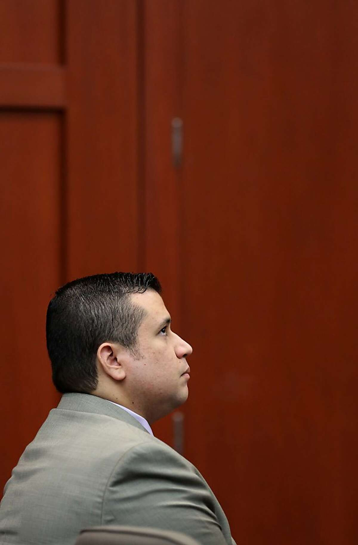 George Zimmerman, accused in the Trayvon Martin shooting, listens to testimony in Seminole circuit court for a pretrial hearing, in Sanford, Fla., Saturday, June 8, 2013.(AP Photo/Orlando Sentinel, Joe Burbank/Pool)