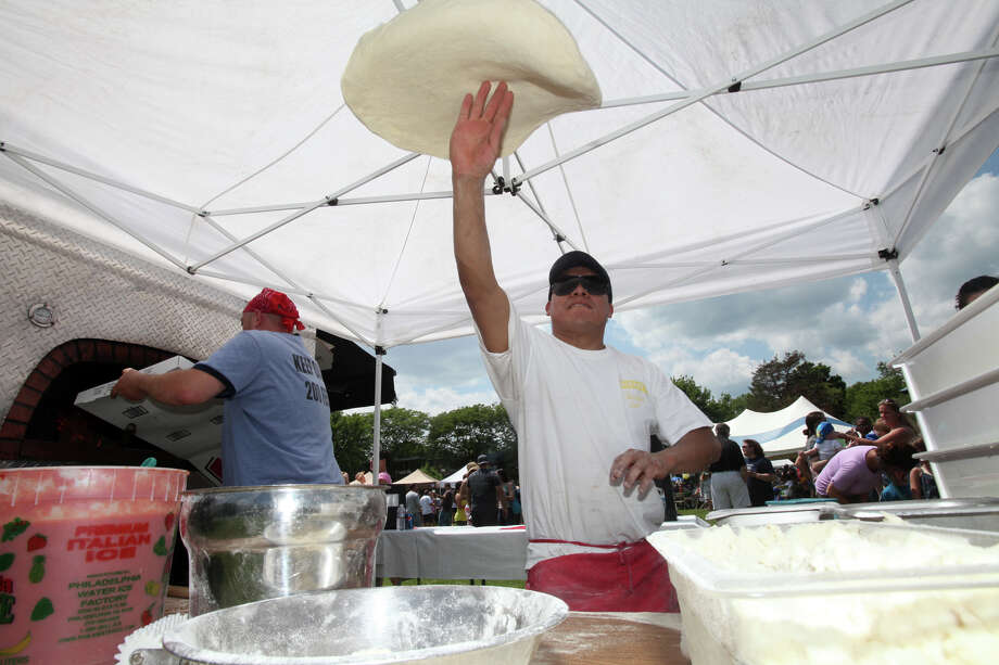 Freddy Quechol makes a pizza for Fire Engine Pizza Co. during Black Rock Day in Bridgeport, Conn. on Sunday, June 9, 2013. Photo: Unknown, B.K. Angeletti / Connecticut Post freelance B.K. Angeletti