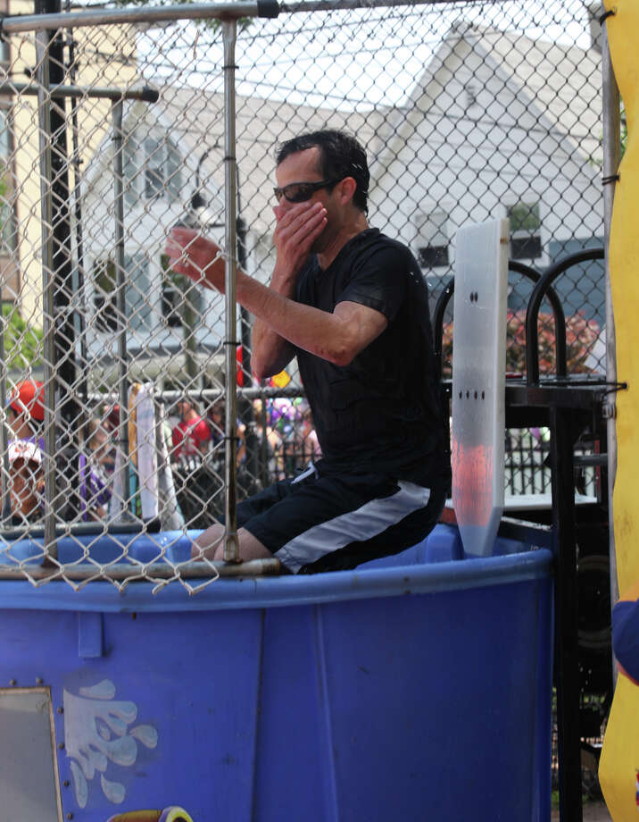 Little League coach Tim Mocklins gets dunked during Black Rock Day in Bridgeport, Conn. on Sunday, June 9, 2013. Photo: Unknown, B.K. Angeletti / Connecticut Post freelance B.K. Angeletti