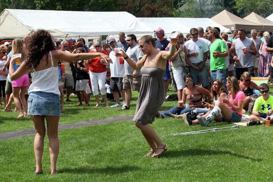 Dena Francesci, left, and Sarah Rosenstein dance during Black Rock Day in Bridgeport, Conn. on Sunday, June 9, 2013. Photo: Unknown, B.K. Angeletti / Connecticut Post freelance B.K. Angeletti