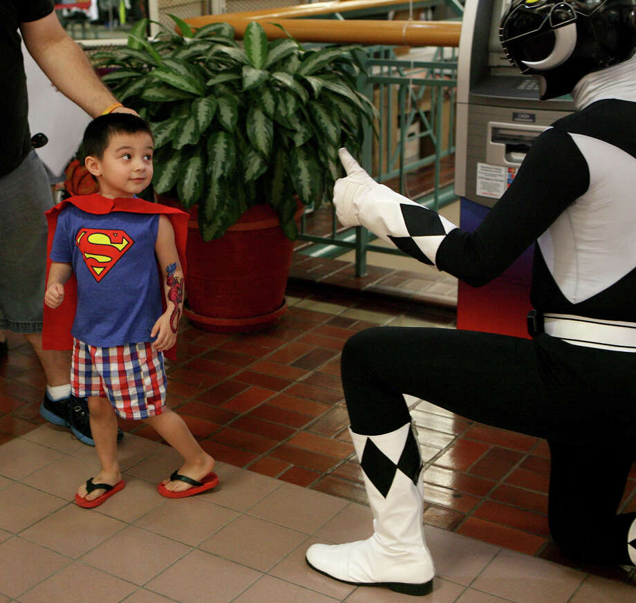 Micah Martin gets excited to see a Power Ranger during the NDG Sci-Fest June 9, 2013 at Wonderland of the Americas. The event is a family friendly event where kids are encouraged to participate. Photo: Cynthia Esparza, For The San Antonio Express-News / For San Antonio Express-News