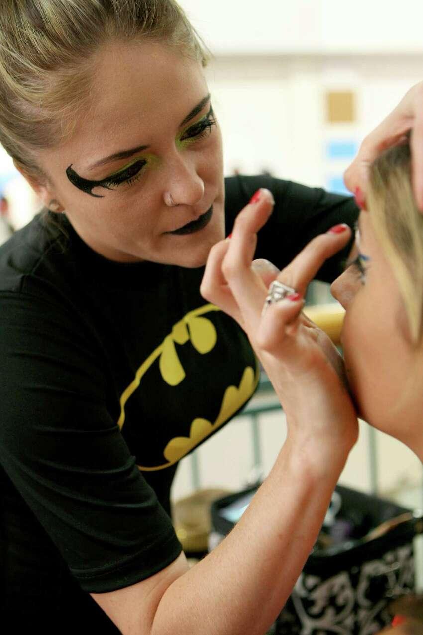 Alyssa Mergele does Samantha DeLeon's make up at the NDG Sci-Fest June 9, 2013 at Wonderland of the Americas.