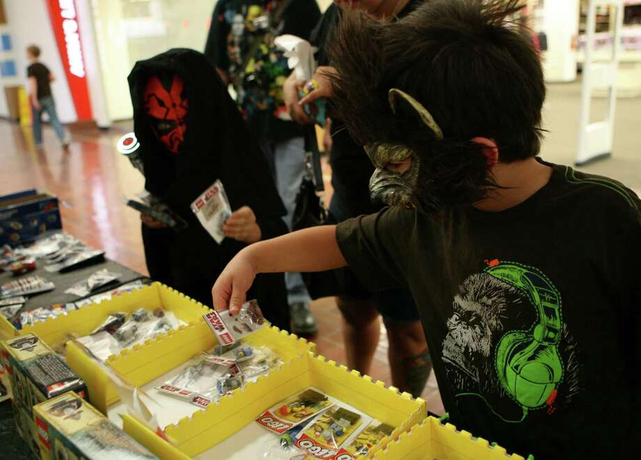 Alejandro Hinojosa (right) dresses as Wolfman as Julian Arriaga dresses as Darth Maul during the NDG Sci-Fest June 9, 2013 at  Wonderland of the Americas. The event is a family friendly event where kids are encouraged to participate. Photo: Cynthia Esparza, For The San Antonio Express-News / For San Antonio Express-News