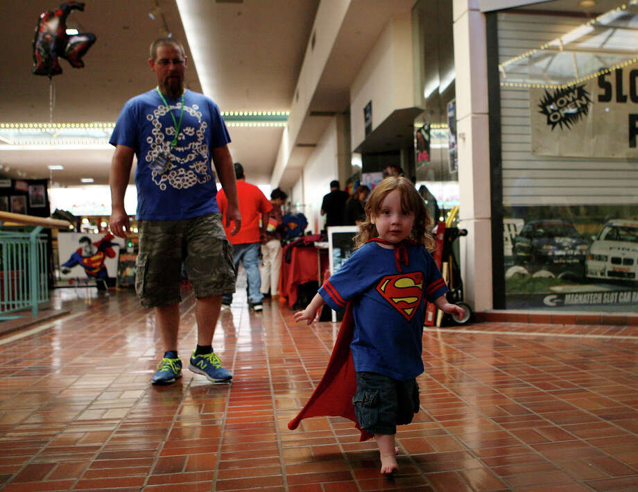 Samuel HIll, 2, runs through Wonderland of the Americas June 9, 2013 with his father, Shawn behind him during the NDG Sci-Fest as they head back to their booth. Samuel suffers from Congenital Nephrotic Syndrome, Finnish type and with this type of disease most only live to about age 7. His family set up a booth and a facebook account, Saving Superman Sam to bring awareness to his disease. Sci-Fest is also doing a fundraiser for them. Photo: Cynthia Esparza, For The San Antonio Express-News / For San Antonio Express-News