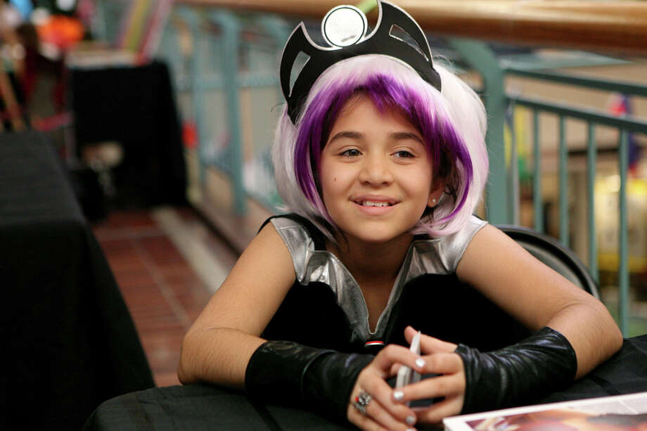 Nikki Sorensen, 10 dresses as Storm from the X-men during the NDG Sci-Fest June 9, 2013 at Wonderland of the Americas. Photo: Cynthia Esparza, For The San Antonio Express-News / For San Antonio Express-News