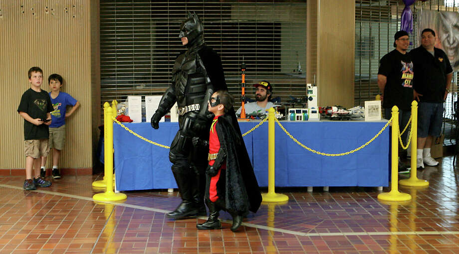 Anthony De La Garza dresses as Batman as his sidekick Austin Vasquez, 5, makes his way around the NDG Sci-Fest as Robin June 9, 2013 at Wonderland of the Americas. De La Garza loves doing Sci-Fest and works for Alamo City Comic Con. Photo: Cynthia Esparza, For The San Antonio Express-News / For San Antonio Express-News