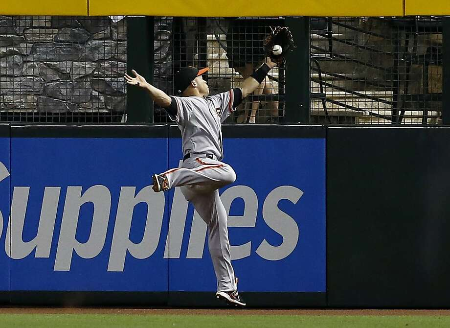 In his first inning as a big-leaguer, center fielder Juan Perez makes a leaping catch at the wall to rob Paul Goldschmidt. Photo: Ross D. Franklin, Associated Press