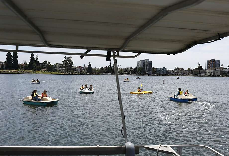 Boaters at the Love Our Lake festival take advantage of a decadelong, $122 million restoration to Oakland's Lake Merritt. Photo: Ian C. Bates, The Chronicle