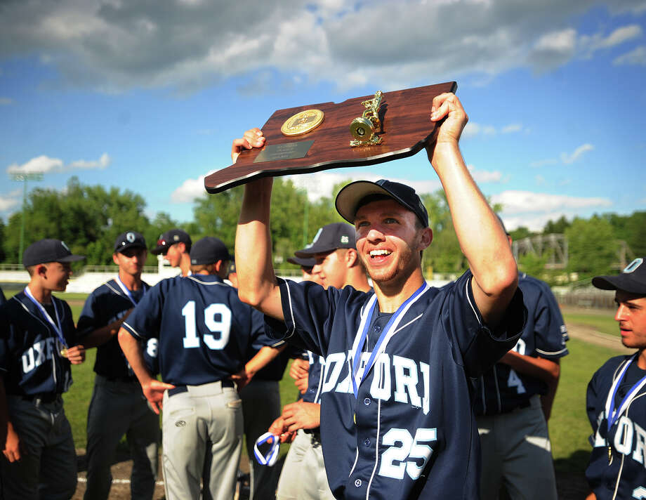 Oxford's James Badas holds the Class S State Championship trophy aloft after his team's 4-0 victory over Cromwell at Palmer Field in Middletown, Conn. on Sunday, June 9, 2013. Photo: Brian A. Pounds / Connecticut Post