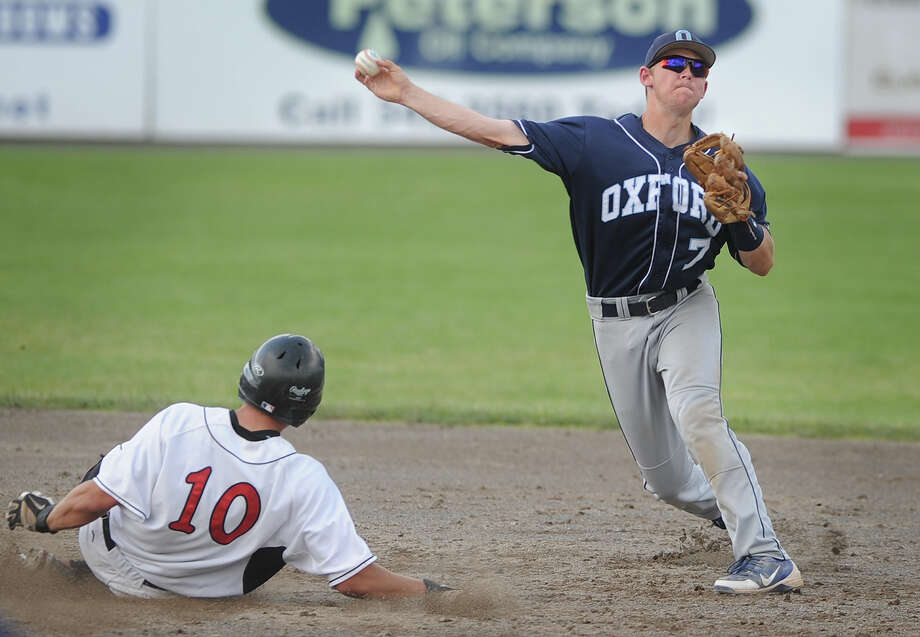 Oxford's Dale Keller turns a double play over sliding Cromwell baserunner Alexander Ramirez during the second inning of the Wolverine's 4-0 victory in the Class S State Championship game at Palmer Field in Middletown, Conn. on Sunday, June 9, 2013. Photo: Brian A. Pounds / Connecticut Post