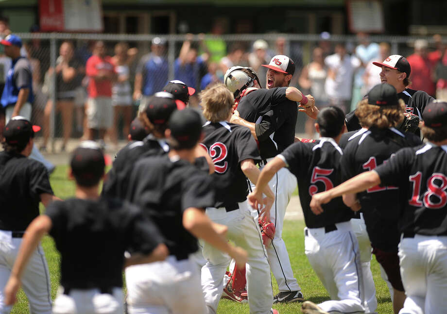 New Canaan teammates celebrate on the mound following their 3-0 victory over Waterford in the Class L baseball championship game at Palmer Field in Middletown, Conn. on Sunday, June 9, 2013. Photo: Brian A. Pounds / Connecticut Post