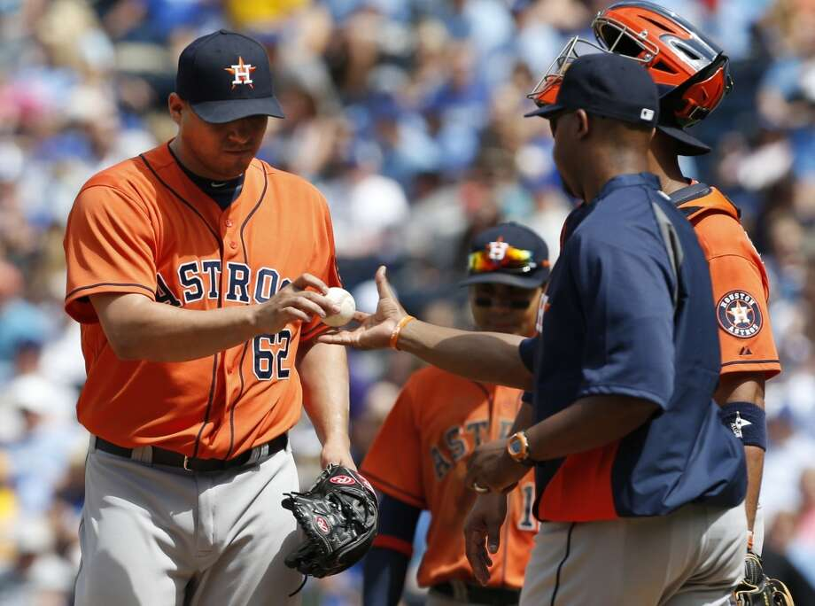 June 9: Royals 2, Astros 0 Bo Porter, right, takes out relief pitcher relief pitcher Hector Ambriz during the eighth inning, after the reliever allowed two runs.  Record: 22-42. Photo: Orlin Wagner, Associated Press