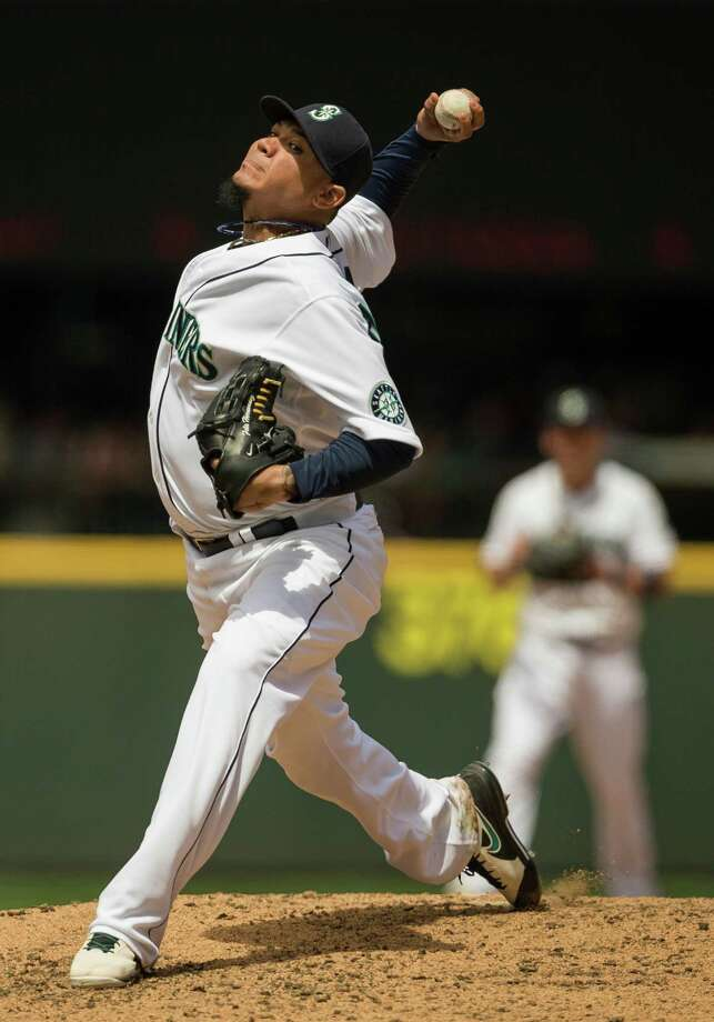 Mariners pitcher Felix Hernandez throws against the New York Yankees during a game Sunday, June 9, 2013, at Safeco Field in Seattle. Nearly 44,000 people attended the sunny day game, and the New York Yankees beat the Mariners 2-1. Photo: JORDAN STEAD, SEATTLEPI.COM / SEATTLEPI.COM
