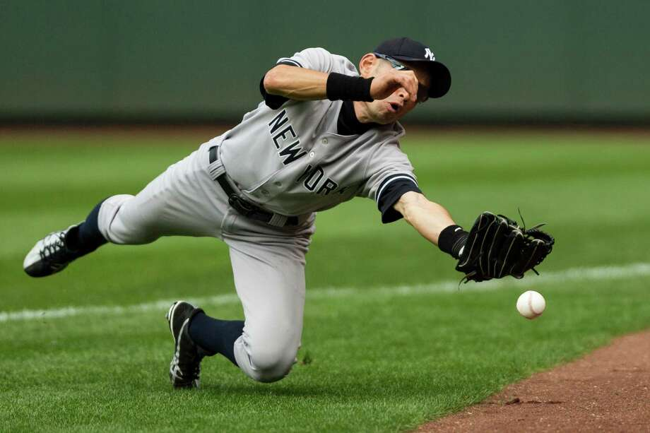 Former-Mariner-turned-Yankee Ichiro Suzuki fumbles a foul out ball during a game against the Mariners Sunday, June 9, 2013, at Safeco Field in Seattle. Nearly 44,000 people attended the sunny day game, and the New York Yankees beat the Mariners 2-1. Photo: JORDAN STEAD, SEATTLEPI.COM / SEATTLEPI.COM
