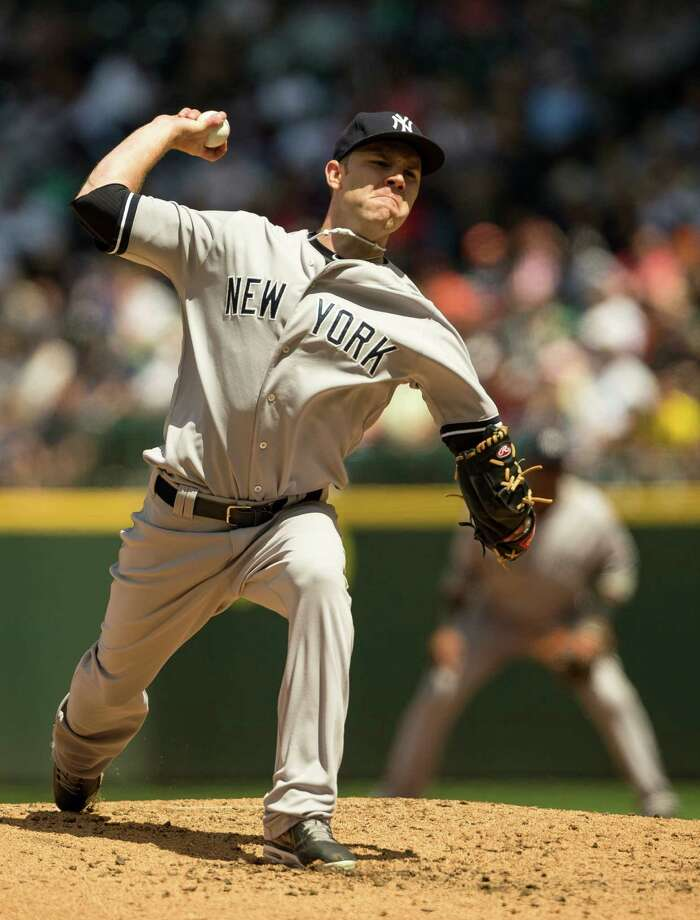 New York Yankees pitcher David Phelps throws against the Mariners during a game Sunday, June 9, 2013, at Safeco Field in Seattle. Nearly 44,000 people attended the sunny day game, and the New York Yankees beat the Mariners 2-1. Photo: JORDAN STEAD, SEATTLEPI.COM / SEATTLEPI.COM