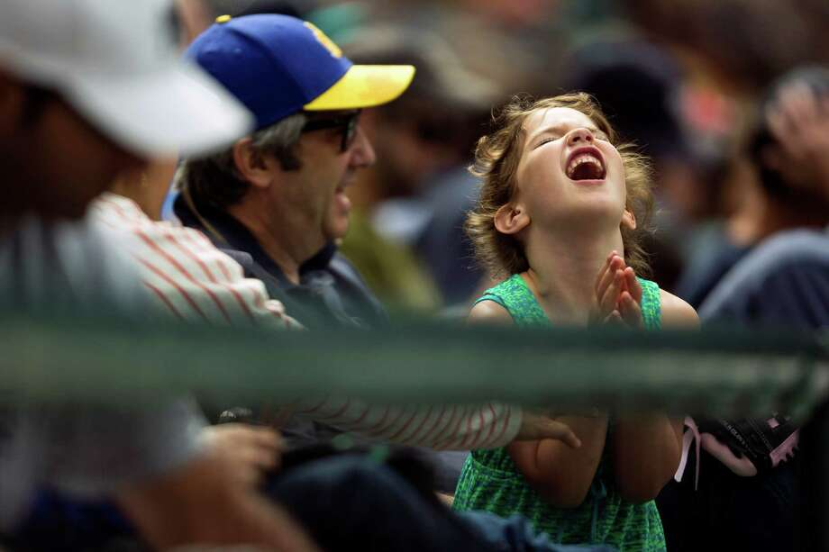 A young lady in the crowd prays hard for a solid hit by the Mariners during a game against the New York Yankees Sunday, June 9, 2013, at Safeco Field in Seattle. Nearly 44,000 people attended the sunny day game, and the New York Yankees beat the Mariners 2-1. Photo: JORDAN STEAD, SEATTLEPI.COM / SEATTLEPI.COM
