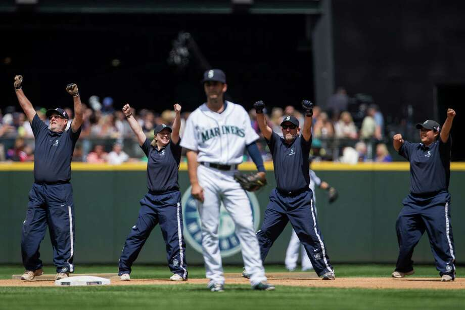 Field officials take a moment between innings to break out into a dance routine to the music being played over the loudspeaker during a Mariners game against the New York Yankees Sunday, June 9, 2013, at Safeco Field in Seattle. Nearly 44,000 people attended the sunny day game, and the New York Yankees beat the Mariners 2-1. Photo: JORDAN STEAD, SEATTLEPI.COM / SEATTLEPI.COM