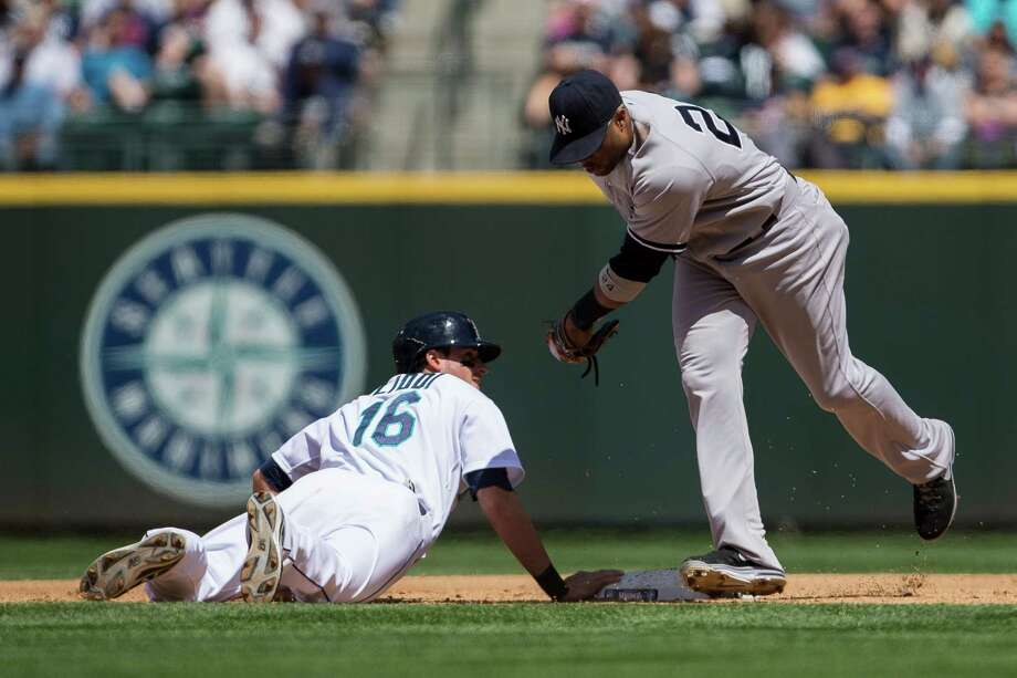 Alex Liddi, left, safely slides into second base during a game against the New York Yankees Sunday, June 9, 2013, at Safeco Field in Seattle. Nearly 44,000 people attended the sunny day game, and the New York Yankees beat the Mariners 2-1. Photo: JORDAN STEAD, SEATTLEPI.COM / SEATTLEPI.COM