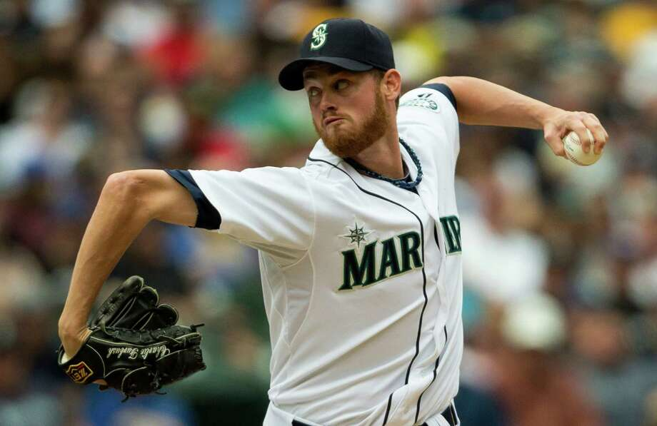 Mariners pitcher Charlie Furbush throws against the New York Yankees during a game Sunday, June 9, 2013, at Safeco Field in Seattle. Nearly 44,000 people attended the sunny day game, and the New York Yankees beat the Mariners 2-1. Photo: JORDAN STEAD, SEATTLEPI.COM / SEATTLEPI.COM