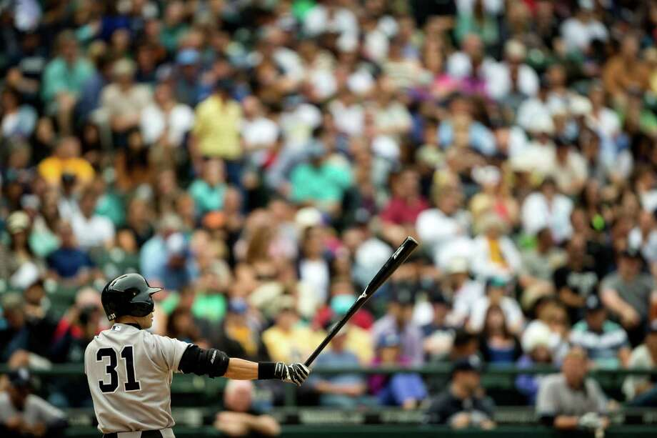 Former-Mariner-turned-Yankee Ichiro Suzuki does his signature bat stretch at the plate during a game against the Mariners Sunday, June 9, 2013, at Safeco Field in Seattle. Nearly 44,000 people attended the sunny day game, and the New York Yankees beat the Mariners 2-1. Photo: JORDAN STEAD, SEATTLEPI.COM / SEATTLEPI.COM