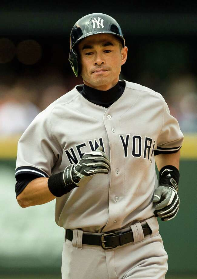 Former-Mariner-turned-Yankee Ichiro Suzuki runs back to the dugout during a game against the Mariners Sunday, June 9, 2013, at Safeco Field in Seattle. Nearly 44,000 people attended the sunny day game, and the New York Yankees beat the Mariners 2-1. Photo: JORDAN STEAD, SEATTLEPI.COM / SEATTLEPI.COM