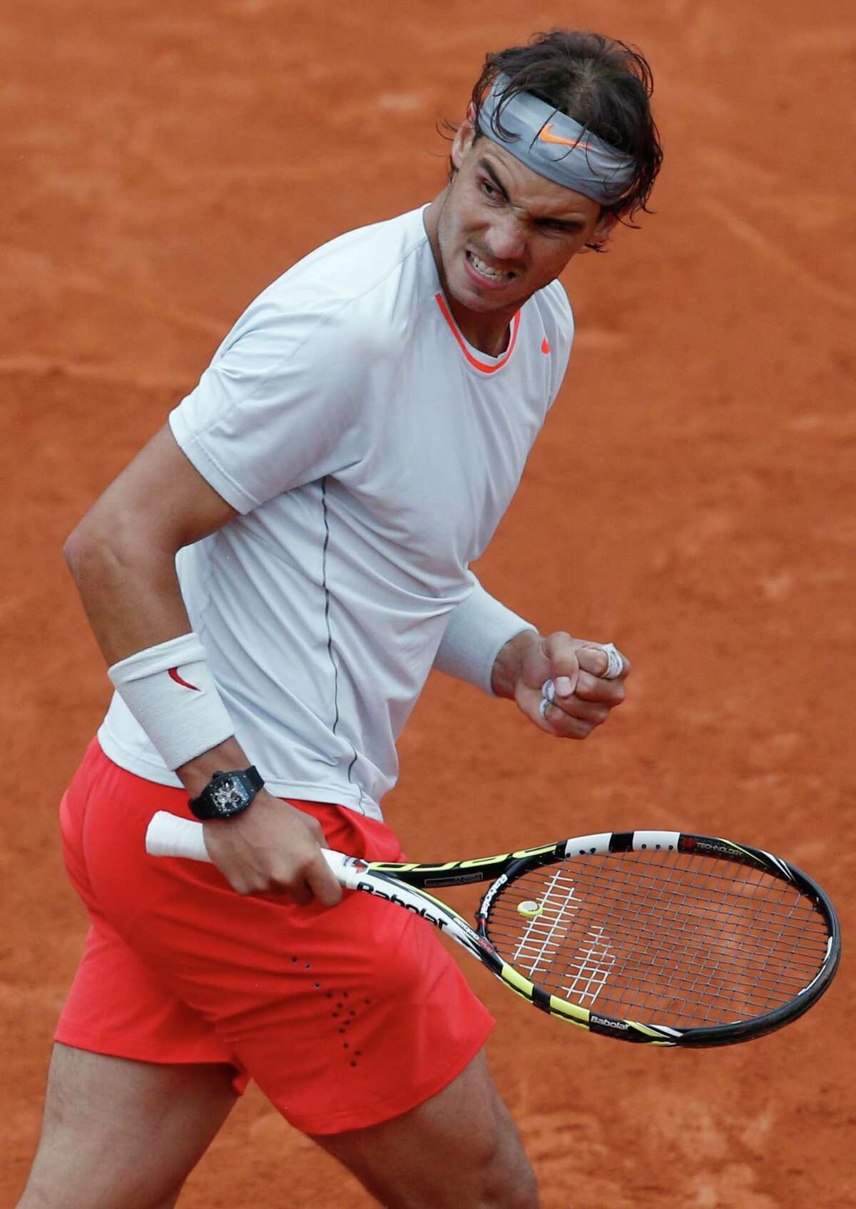 Spain's Rafael Nadal clenches his fist after scoring against compatriot David Ferrer in the final of the French Open tennis tournament, at Roland Garros stadium in Paris, Sunday June 9, 2013. Nadal won the tournament in three sets 6-3, 6-2, 6-3. (AP Photo/Christophe Ena)