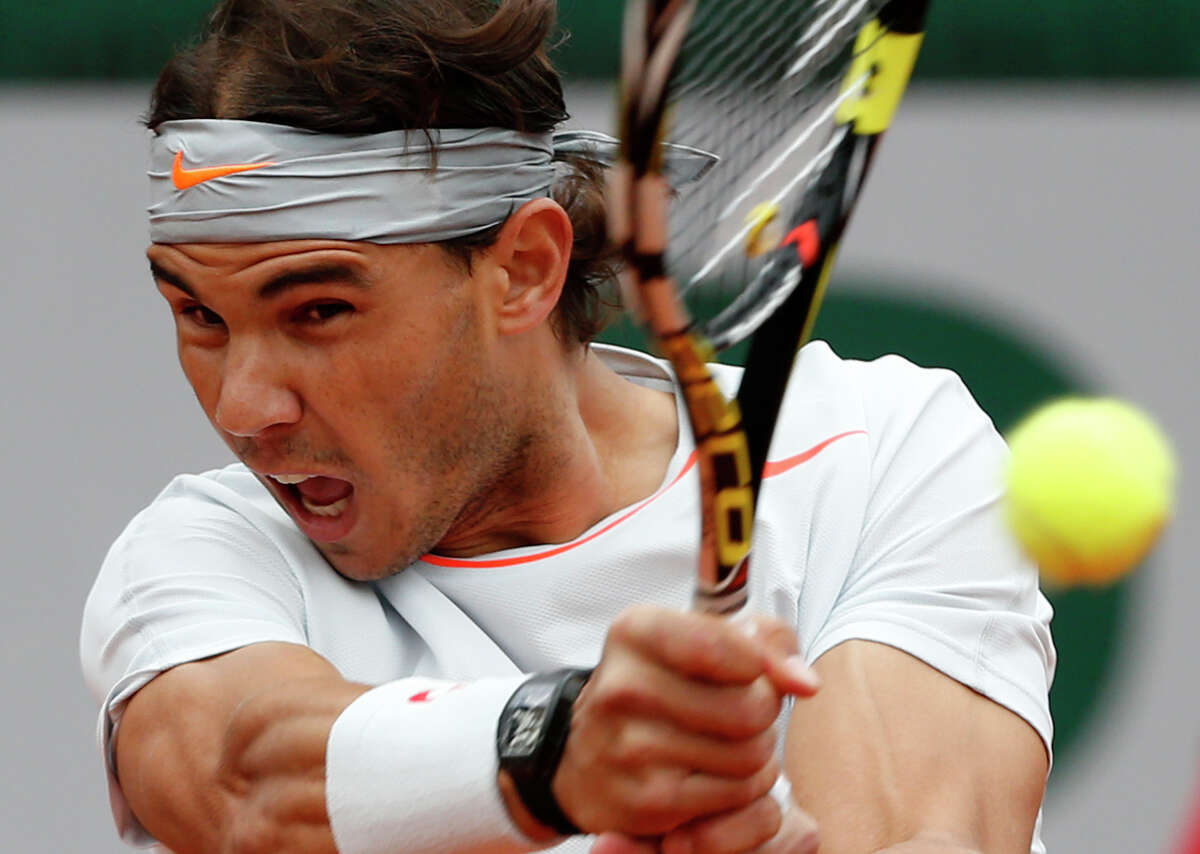 Spain's Rafael Nadal returns the ball to compatriot David Ferrer during the men's final match of the French Open tennis tournament at the Roland Garros stadium Sunday, June 9, 2013 in Paris. (AP Photo/Petr David Josek)