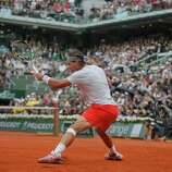 Spain's Rafael Nadal returns against compatriot David Ferrer in the final of the French Open tennis tournament, at Roland Garros stadium in Paris, Sunday June 9, 2013. (AP Photo/Michel Spingler)