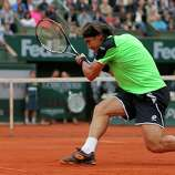 Spain's David Ferrer returns the ball to compatriot Rafael Nadal during the men's final match of the French Open tennis tournament at the Roland Garros stadium Sunday, June 9, 2013 in Paris. (AP Photo/Michel Spingler)