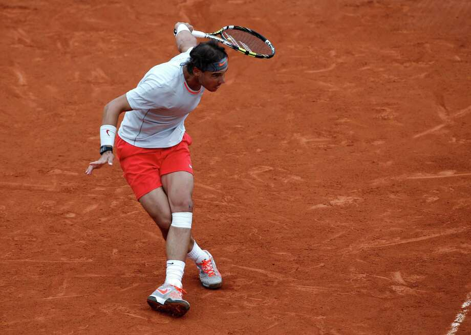 Spain's Rafael Nadal returns the ball to compatriot David Ferrer during the men's final match of the French Open tennis tournament at the Roland Garros stadium Sunday, June 9, 2013 in Paris. (AP Photo/Christophe Ena) Photo: Christophe Ena
