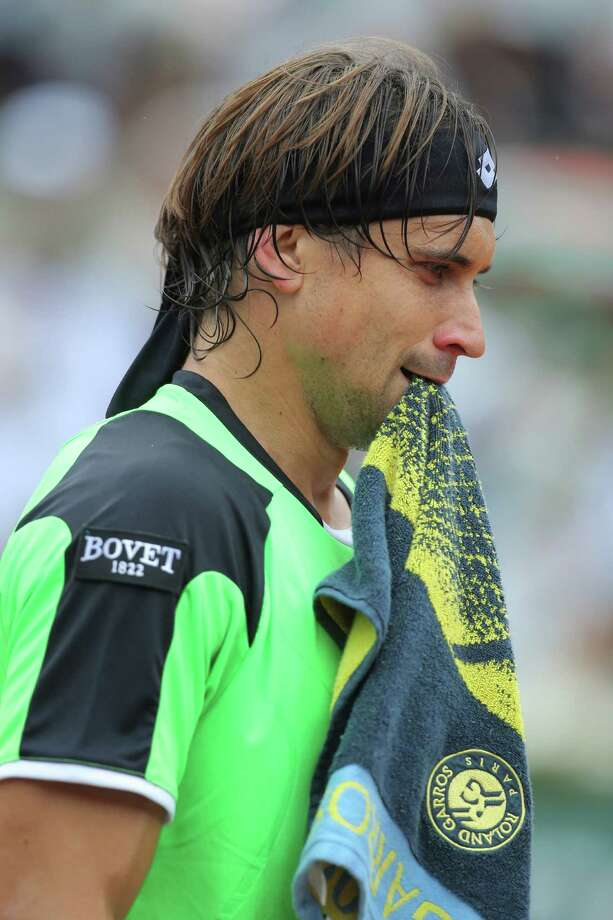 Spain's David Ferrer holds his towel in his match against compatriot Rafael Nadal in the final of the French Open tennis tournament, at Roland Garros stadium in Paris, Sunday June 9, 2013. Nadal won in three sets 6-3, 6-2, 6-3. (AP Photo/Michel Euler) Photo: Michel Euler