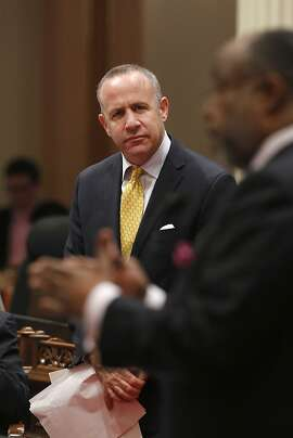 In this photo taken Wednesday, May 29, 2013, state Senate President Pro Tem Darrell Steinberg, D-Sacramento, left,  listens as Sen. Rod Wright, D-Inglewood, urged defeat of a Steinberg's measure to prohibit the sale, purchase, manufacture, importation or transfer of semi-automatic riles with detachable magazines, during the Senate session in Sacramento, Calif.  Despite opposition, the bill SB374, was approved and sent to the Assembly.  State lawmakers have ended the first half of this year's legislative session by advancing hundreds of bills addressing a wide range of issues, including gun control, environmental protection, oil drilling and whether prison inmates should have access to condoms.(AP Photo/Rich Pedroncelli)