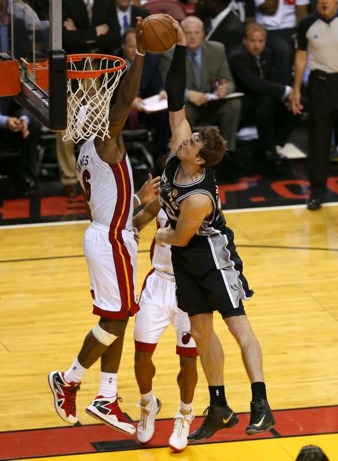 Heat forward LeBron James rejects a shot from Thiago Splitter of the Spurs. Photo: Mike Ehrmann, Getty Images