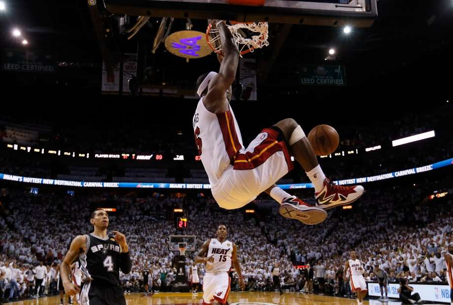 LeBron James of the Heat puts down a ferocious dunk against the Spurs during Game 2. Photo: Christian Petersen, Getty Images