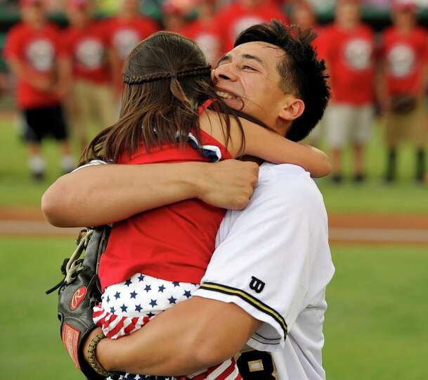 Five-year-old Hailey Sandoval, left, hugs her father, Army Staff Sgt. Alvino Sandoval, before a Texa