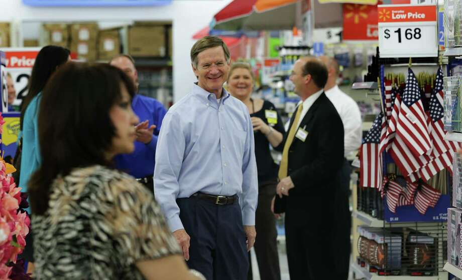 U.S. Rep. Lamar Smith, center, visits a Wal-Martstore on Loop 1604 in San Antonio on Friday. Photo: Bob Owen, Staff / © 2012 San Antonio Express-News