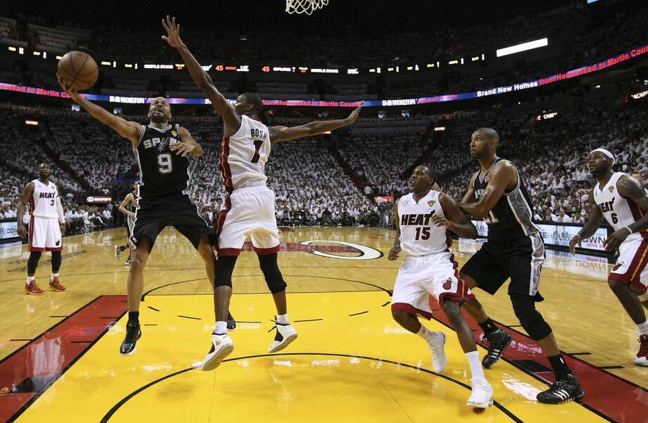 Spurs' Tony Parker (09) drives the lane against the Miami Heat's Chris Bosh (01) during the first half of Game 2 of the NBA Finals at the American Airlines Arena in Miami on Sunday, June 9, 2013. (Kin Man Hui/San Antonio Express-News) Photo: Kin Man Hui, San Antonio Express-News