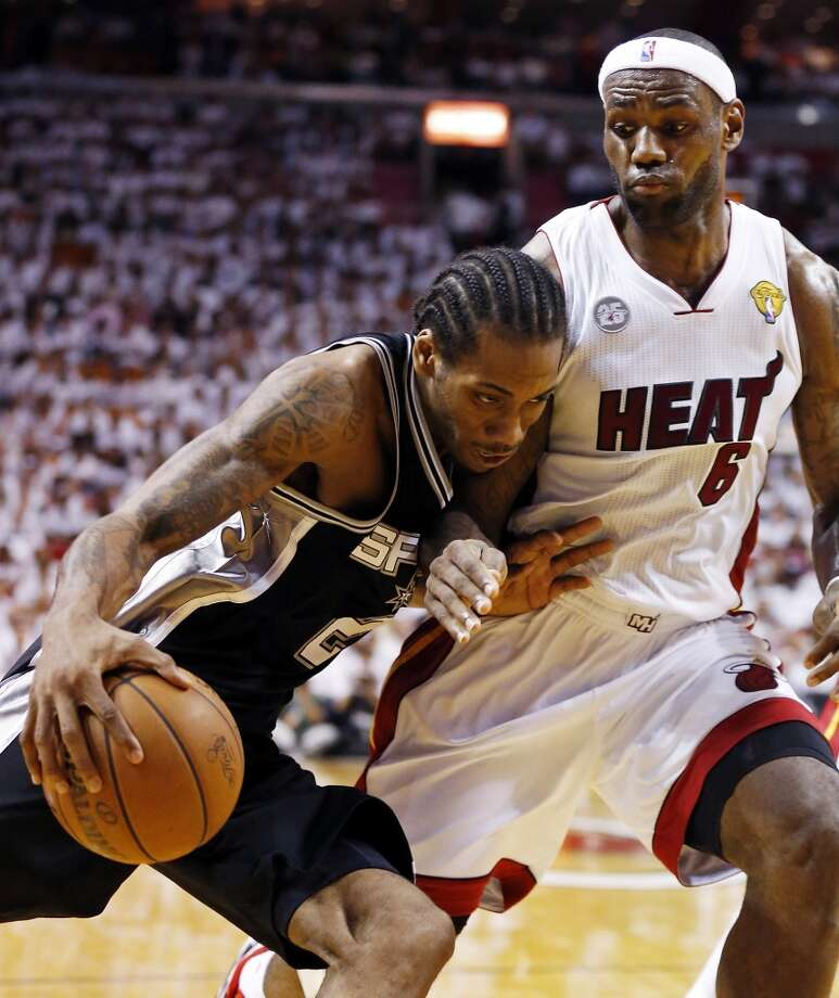 San Antonio Spurs' Kawhi Leonard looks for room around Miami Heat's LeBron James during second half action in Game 2 of the 2013 NBA Finals Sunday June 9, 2013 at American Airlines Arena in Miami, Fla.
