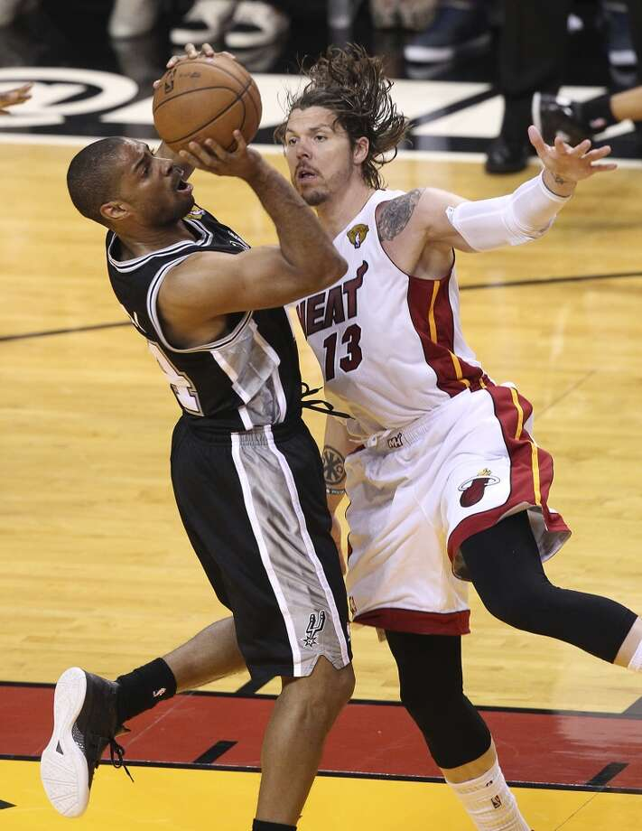 Spurs' Gary Neal (14) gets pressure from the Miami Heat's Mike Miller (13) during the first half of Game 2 of the NBA Finals at the American Airlines Arena in Miami on Sunday, June 9, 2013. (Kin Man Hui/San Antonio Express-News)