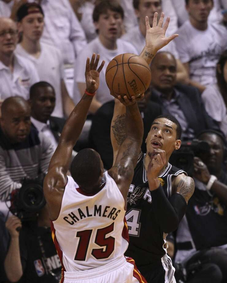 Spurs' Danny Green (04) goes up to defend against the Miami Heat's Mario Chalmers (15) during the first half of Game 2 of the NBA Finals at the American Airlines Arena in Miami on Sunday, June 9, 2013. (Kin Man Hui/San Antonio Express-News)