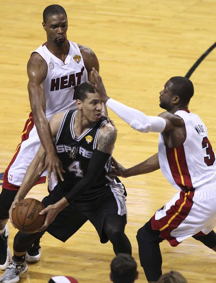 Spurs' Danny Green (04) gets defended by the Miami Heat's Chris Bosh (01) and Dwyane Wade (03) during the first half of Game 2 of the NBA Finals at the American Airlines Arena in Miami on Sunday, June 9, 2013. (Kin Man Hui/San Antonio Express-News)