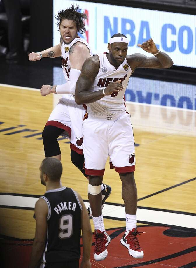 Miami Heat's Mike Miller (13) and LeBron James (06) celebrate after James' dunk against the Spurs in the second half of Game 2 of the NBA Finals at the American Airlines Arena in Miami on Sunday, June 9, 2013. The Heat take Game 2 over the Spurs, 103-84. (Kin Man Hui/San Antonio Express-News)