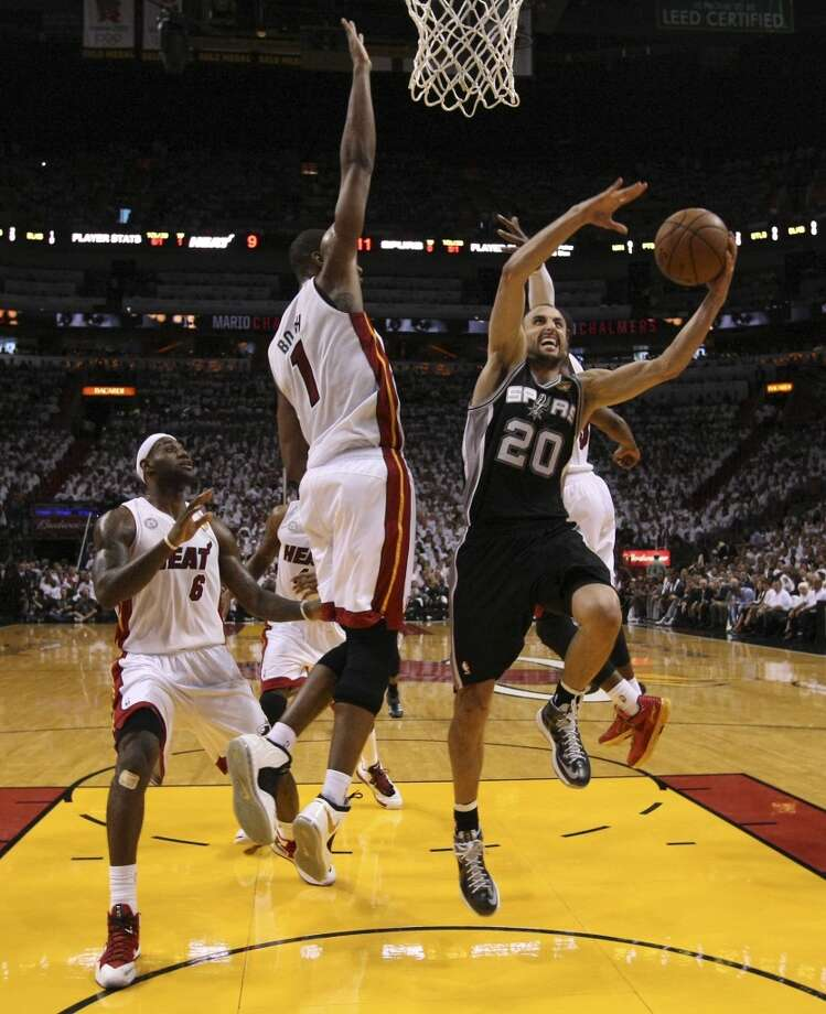 Spurs' Manu Ginobili (20) goes for a layup against Miami Heat's Chris Bosh (01) during the first half of Game 2 of the NBA Finals at the American Airlines Arena in Miami on Sunday, June 9, 2013. (Kin Man Hui/San Antonio Express-News)