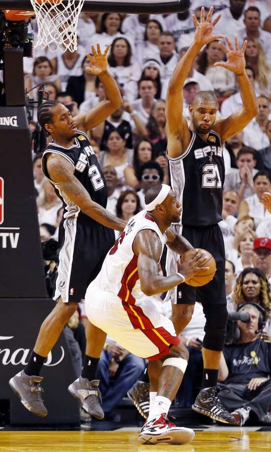 San Antonio Spurs' Kawhi Leonard and San Antonio Spurs' Tim Duncan defend Miami Heat's LeBron James during second half action in Game 2 of the 2013 NBA Finals Sunday June 9, 2013 at American Airlines Arena in Miami, Fla.
