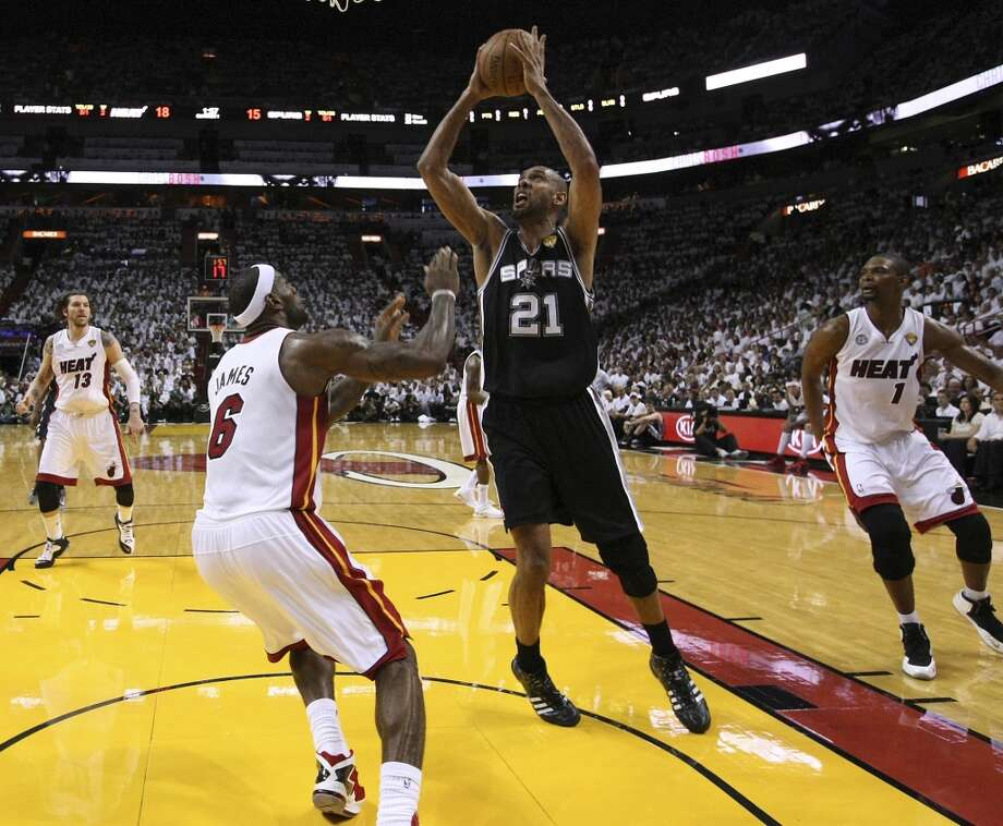 Spurs'Tim Duncan (21) goes up for a shot against Miami Heat's LeBron James (06) during the first half of Game 2 of the NBA Finals at the American Airlines Arena in Miami on Sunday, June 9, 2013. (Kin Man Hui/San Antonio Express-News)