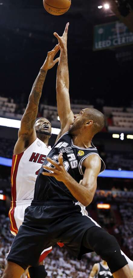 San Antonio Spurs' Tim Duncan shoots over Miami Heat's Udonis Haslem during first half action in Game 2 of the 2013 NBA Finals Sunday June 9, 2013 at American Airlines Arena in Miami, Fla.
