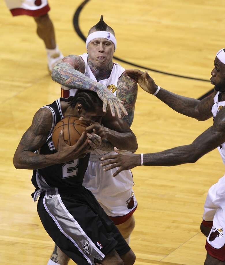 Spurs' Kawhi Leonard (02) gets fouled by the Miami Heat's  Chris Andersen (11) during the first half of Game 2 of the NBA Finals at the American Airlines Arena in Miami on Sunday, June 9, 2013. (Kin Man Hui/San Antonio Express-News)