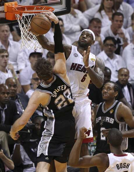 Miami Heat's LeBron James (06) blocks Spurs' Tiago Splitter (22) on a dunk attempt during the second half of Game 2 of the NBA Finals at the American Airlines Arena in Miami on Sunday, June 9, 2013. Miami takes Game 2 over the Spurs, 103-84. (Kin Man Hui/San Antonio Express-News)